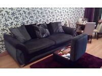 4 seater settee with matching footstool. Black and grey. Excellent condition.
