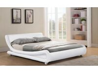 White faux leather double bed