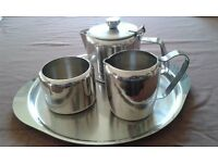 Stainless steel tea set with tea pot, sugar bowl, milk jug and tray, in VGC