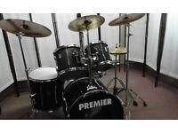 Retired drum teacher has a Premier 'APK' Drum set with Paiste cymbals & new drum bags for sale.