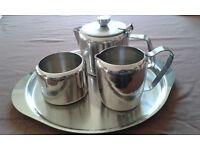 Stainless steel tea set with tea pot, sugar bowl, milk jug and tray