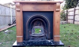 Iron fire with wooden mantle and marble hearth