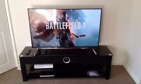 65 inch TV stand with 4 built in speakers and a sub