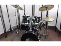 Retired drum teacher has a Yamaha Stage Custom Fusion drum kit for sale