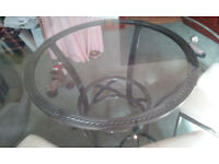 Round glass dining table with 4 upholstered chairs