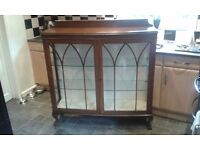 Antique bow front display cabinet