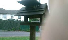 Bird table for sale with nut feeder in roof