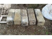Five genuine stone pillar bases reclaimed from an old barn