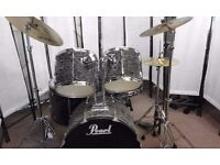 Retired drum teacher has a Pearl Export drum kit for sale.