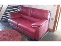 Red Italian leather 2 seater sofa