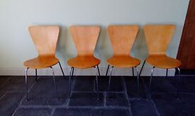 Four Arne Jacobsen style stacking chairs