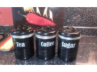 Three Typhoon kitchen canisters in black