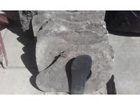Selection of solid stone slabs, stepping stones and bricks. Used but in good condition