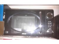 BRAND NEW !!! MICROWAVE = AKAI = 20 LITRES RRP £ 69 Special offer !!!