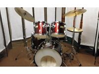 Retired drum teacher has an Aria drum kit with Pearl cymbals for sale.