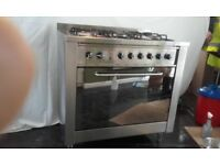INDESIT DUEL FUEL FREE STANDING COOKER GAS AND ELECTRIC