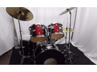 Retired drum teacher has a Pearl Forum drum kit in Wine Red for sale.