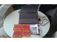 OLIVETTI DORA 201 ELECTRONIC TYPEWRITER INCLUDING 3x NEW RIBBONS 5x CORRECTING RIBBONS