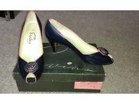Designer vintage shoes as NEW