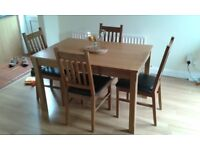 Dining room table and 4 chairs. The table extends as seem in the photos