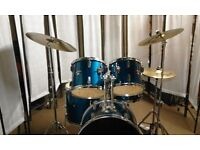Retired drum teacher has a 'Drum World' drum kit with upgraded cymbals for sale.
