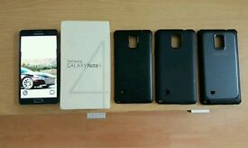 Samsung galaxy note 4 unlocked 32gb with 64gb card cases and box