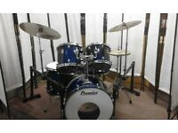 Retired drum teacher has a Premier 'XPK' Drum set with Paiste cymbals & new drum bags for sale.