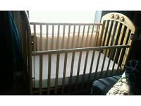 A cot bed for sale.