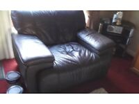 Brown leather three seater sofa and one chair and pouffe