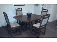 oak gate leg dinning table and four oak chairs