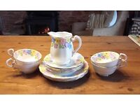 Bone China tea set by Royal Standard. 4 cups, saucers and tea plates + milk jug. Very pretty.