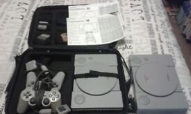 2xps1 100games 2xpads 6xmemory cards 1xpsp carry case all leads 1x gun 1xpsp 3games