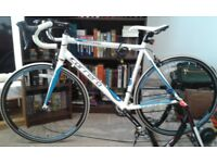 Gents carrera virtuoso racing cycle in blue and white with accompanying exercise frame for indoors