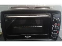 Table top electric cooker with hobs and oven clean condition can deliver