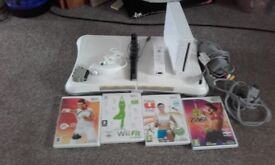 wii fit board and 4 games