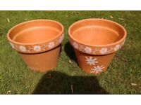 2 patterned clay garden pots