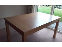 Extending dining table, seats 8