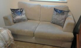2 seater and 3 seater sofas and storage foot rest. Dfs grey material, good condition £95