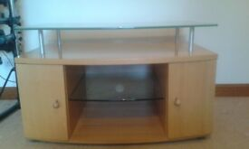 TV unit. Ver solid with glass shelf and pull out storage.