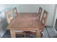Pine dining table & six chairs. Table as two extension leafs. Size W 150 - 240 D 85 H 76.
