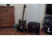 Gibson Eppiphone guitar and Peavey amp