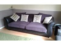 Large leather and fabric sofa