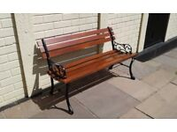 Completely refurbished garden bench wrought iron ends abd treated wooden slats