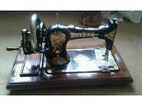 Jones sewing machine and cottons (cottons not shown)