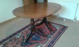 VINTAGE OVAL TWIN PEDESTAL DINING TABLE MAHOGANY WALNUT BANDING EBONY STRINGING BRASS DOGS CASTORS
