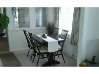 Solid wood dining table and four chairs cottage style made by ercol