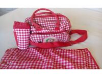 Baby change bag with mat and bottle holder