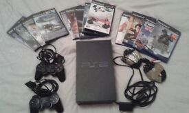 Playstation 2 with two controllers and 11 games