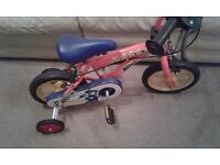 Childrens fireman Sam bike with stabilizers. Red not pink as in photo