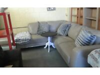 grey leather corner sofa with foot stool also comes with throw and 3 extra cushions £335.00